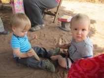 Francis and Malachi playing in the sand before church